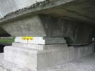 Bearing on concrete superstructure